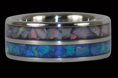 Australian Opal Titanium Ring with double red and blue opal inlays http://www.hawaiititaniumrings.com/collections/limited-edition-opal-titanium-rings/products/blue-and-red-opal-inlay-titanium-ring