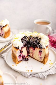 This Lemon Blueberry Cheesecake is tangy and creamy. This easy cheesecake recipe is topped with a homemade blueberry sauce and fresh whipped cream