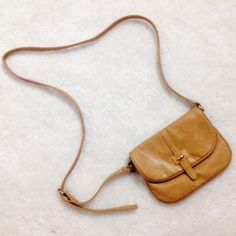 Tan purse Good condition.  Strap has 5 adjustments.  Purse snaps shut.  Zipper pocket on back.  Small side pocket on inside of purse. Charlotte Russe Bags Crossbody Bags