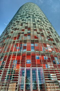 VERY bad move, Barcelona (colored glass does NOT an architecture make). And WTF does this building have to do with the Barcelona that we knew and loved . It is a TRAGEDY of a grand order. Interesting Buildings, Amazing Buildings, Modern Buildings, Amazing Architecture, Contemporary Architecture, Architecture Design, Jean Nouvel, Gaudi, Begur Costa Brava