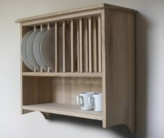 Something like this above serving hatch?  Wall-mounted oak plate rack shelf aplaceforeverything.co.uk