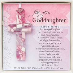 A unique gift for a girl on her Confirmation baptism or first communion day. Handmade in the USA glass cross; each mosaic uniquely made with pink and white glass. Gift boxed with touching sentiment for special Goddaughter for any occasion.  Features  Glass cross handmade in the USA  Cross measures 4 long  Can be hung as sun catcher on rear view mirror door knob Christmas tree or ornament stand  Comes with Goddaughter sentiment and message of faith  Gift boxed in white 5.55.5 inch clear top…