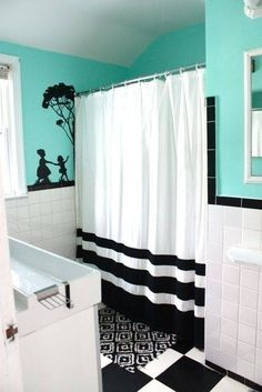 neat silouette idea for black and white bathroom, also really like the brighter blue