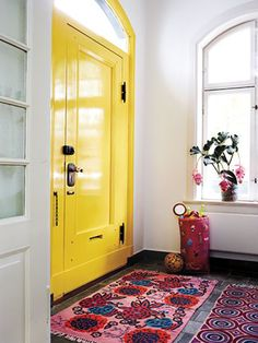 Take a peek at our favorite yellow doors from around the web. As an interior or exterior accent, this bright hue is bound to shake up your home with color. For more paint and color ideas and home design trends go to Domino. Home Decor Inspiration, Home Accents, House Design, Colorful Interiors, Yellow Doors, Interior Inspiration, Painted Front Doors, House Interior, House Colors