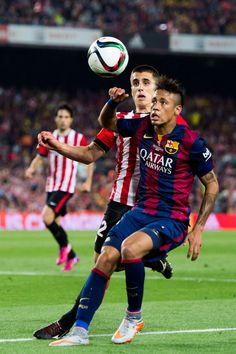 Neymar Santos Jr (R) of FC Barcelona fights for the ball with Unai Bustinza of Athletic Club during the Copa del Rey Final between Athletic Club and FC Barcelona at Camp Nou on May 30, 2015 in Barcelona, Catalonia.