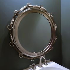 A Nautical Rope Is Woven Through The Rings Of This Cool Porthole Mirror To  Make A