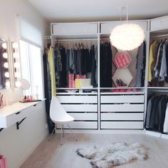 Walk-in-closet with Ikea 'Pax' and 'Alex' wall-mounted drawers