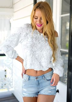 Like its baby pink variant, this white 3D rose top is another one of our best sellers and for a very good reason.