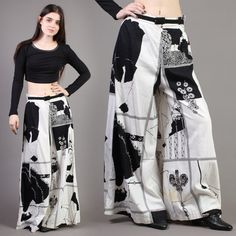 DESCRIPTION  Amazing 1970s palazzo pants! Pants feature the artwork of Aubrey Beardsley. Best black and white colors. High waist cut. Pants are