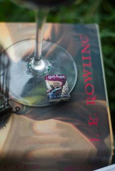 Tiny Books Wine Charms, $30 | 19 Things Everyone Who Loves Harry Potter And Booze Needs To Own