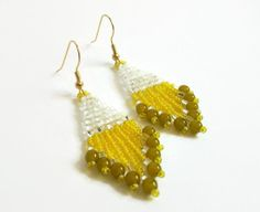 Yellow olive warmth by plantedfeet on Etsy. Visit this treasury to see one of my yarns!