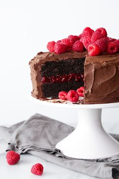 Chocolate-Raspberry Layer Cake This chocolate cake is moist, delicious, and vegan friendly! It has a generous layer of a raspberry chia filling in the center and a fluffy chocolate frosting! Gluten and refined sugar free variation included. Chocolate Raspberry Cake, Raspberry Syrup, Chocolate Frosting, Vegan Chocolate, Chocolate Cake, Raspberry Filling, Rasberry Cake, Strawberry Cakes, Whipped Ganache