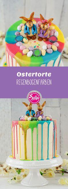Eine süße Ostertorte mit bunten Regenbogenfarben und Schokoladen Häschen zu Ostern.