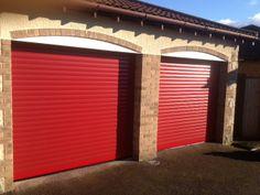 Red roller garage doors installed in Bourne.