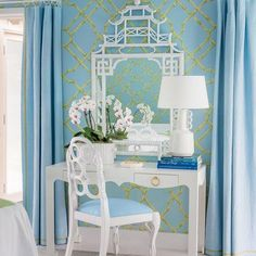 Meg Braff - Coastal Living A wonderful vignette with many favorites - a Frances Elkins loop chair, a Chinese Chippendale pagoda mirror, bamboo trellis wallpaper, and a blue and white palette.