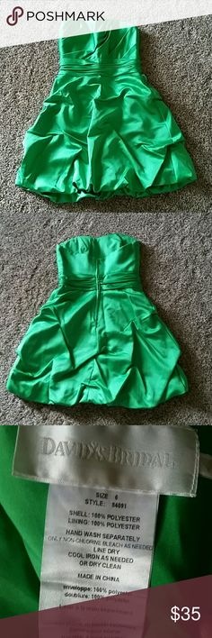 Davids Bridal short pick-up dress 6 Size 6 green David's Bridal dress. No alterations made to dress. Worn once. Pickups sewn in front and back. Zipper up the back. Sweetheart strapless neckline. Would be great for holiday parties!! Bundle for a discount. David's Bridal Dresses