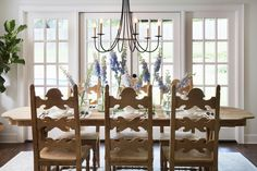 The light fixture in the dining room ties in the traditional style the Sandvalls were going for, and the french doors make the space feel open and bright—just like the living room.