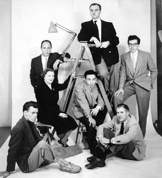 Members of the Painters Eleven during the Simpson's department store Abstracts at Home display, 1953. From left: Tom Hodgson, Oscar Cahén, Alexandra Luke, Kazuo Nakamura, Ray Mead, Jack Bush, and William Ronald. Photo by Everett Roseborough.