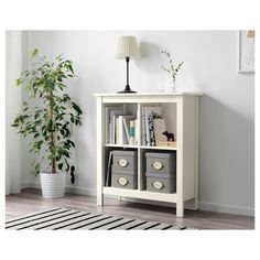 And perhaps the lower version under the glass shelves/tv?  IKEA TOMNÄS shelving unit Easy to place anywhere in your home.