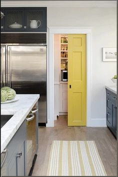 Very cute little pocket door for the pantry.