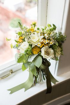 green, yellow, and ivory bouquet // photo by Meghan Christine // http://ruffledblog.com/lawyers-in-love-wedding-inspiration