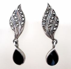 """Black Onyx & Marcasite Sterling Silver Earrings Pierced Dangle Vintage Jewelry  This is a pair of sterling silver pierced earrings with black onyx dangles and marcasites.    They weigh 3.4 grams, measure 1.25"""" by .38"""", marked 925."""