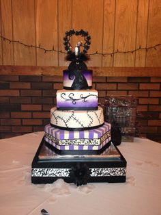 Nightmare Before Christmas Wedding Cake - 1st and 3rd tiers are chocolate cake with espresso ganache filling and the 2nd and 4th tiers are red velvet with vanilla fluff mousse.