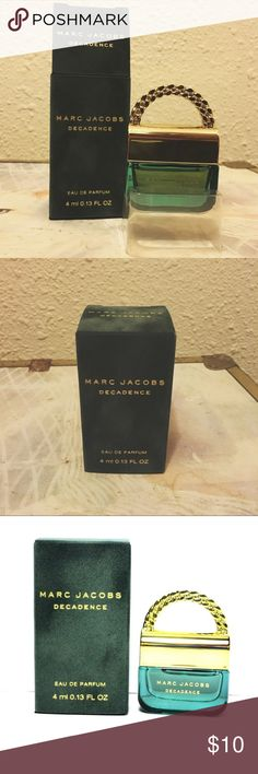 Marc Jacobs Decadence 4ml NEW IN BOX NEW IN BOX. Marc Jacobs Decadence 4ml Original Price $20 A sensual, luxurious, woody fragrance, Marc Jacobs Decadence captures the spirit of irreverent glamour.Fragrance Notes Italian plum, iris flower, saffron, Bulgarian rose, jasmine sambac, orris, vetiver, papyrus woods and liquid amber. Marc Jacobs Makeup