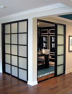 interior sliding doors room dividers - This would be ideal for a dining room which could double as study space.  Make bookshelves with flipper doors or tambour to hide the clutter for dining use.