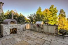 Cool Outdoor Kitchen And Pizza Oven Design With Rustic Decoration Ideas Made From Stone Material Combined With Stone Tile Flooring Design Ideas