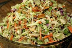 "Oriental Slaw / 2 (3 oz) pkg beef-flavor ramen noodles (crushed 1"" pieces), 2 (8.5 oz) pkg broccoli coleslaw, 1 c. toasted slivered almonds, 1 c. sunflower seeds, 1/2 bunch green onion chopped, 1/2 c. sugar, 3/4 c. oil, 1/3 c. white vinegar. Directions: Place noodles in bottom of lrg bowl, broccoli slaw, almonds, sunflower kernels, and green onions. 3.) In a separate bowl combine sugar, oil, vinegar and flavor pkts. Pour over slaw, cover & chill up to 24 hours. 4.) Toss before serving."