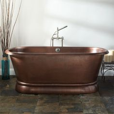 """Spacious and luxurious, the 72"""" Kaela Hammered Copper Double-Ended Tub is a splurge to please even the most discerning giftee."""