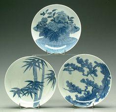 Three Nabeshima-style plats, bamboo, flower basket and pine tree
