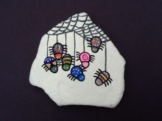 Hand painted rock - Spiders by Phyllis Plassmeyer