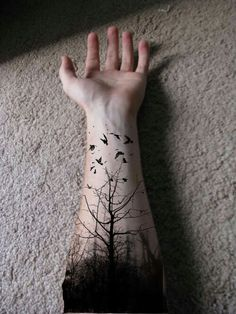 Arm tree tattoo. That's just awesome