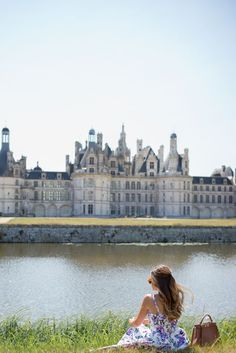 nibble on a baguette with cheese behind the Château de Chambord in the Loire Valley of France.
