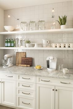 Butler pantry covered in ceramic tiles that give the perfect shine. Urban Farmhouse - Brianna Michelle Interior Design