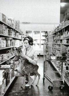 cute Adurey Hepburn with a deer in the market