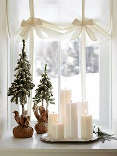 in Snow-White Style - Group candles in a window for a warm holiday decoration. For more shots of this house: www.midwestl -Decorate in Snow-White Style - Group candles in a window for a warm holiday decoration. For more shots of this house: www. Noel Christmas, Little Christmas, Christmas And New Year, Winter Christmas, All Things Christmas, Christmas Candles, Christmas Vignette, Rustic Christmas, Modern Christmas
