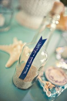 Love this message in a bottle for table decor.