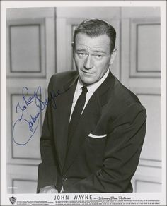 "John Wayne - Photo Publicitaire - Warner Bros Pictures - Dédicacée ""To Ray, John Wayne"""