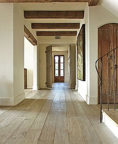 amazing floors - bleached oak. Love the ceiling beams and the light.