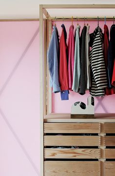 Studiomama has created a pastel-coloured wardrobe with doors that unfold into a partition for large rooms