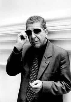 Photo of Leonard COHEN posed wearing sunglasses