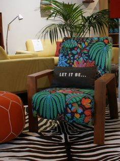 Our Mogambo chair covered in Sanderson Rainforest 'multi'.