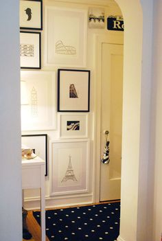 Make an interesting gallery wall by having frames go all the way to the floor. Give it an extra 'punch' by using black and white frames