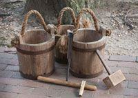 Tools of the maple syrup trade: an auger to bore a hole in the tree, a mallet to tap the wooden spile in, and buckets to collect the sap.