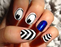 Chevrons and cartoon eyes with Essie Aruba Blue as a reverse accent nail