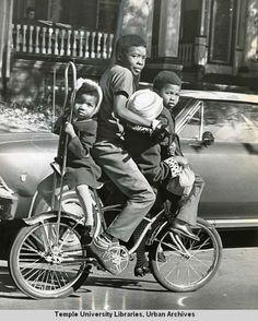 """Mass Transit means four on a bike for youngsters making a trip along 54th st. near Chester av. in West Philadelphia."" Philadelphia Evening Bulletin, November 1 1969."