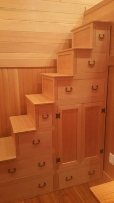 Gorgeous custom made storage staircase!  The Doug Fir Tiny House on Wheels by Shibui Woodworking